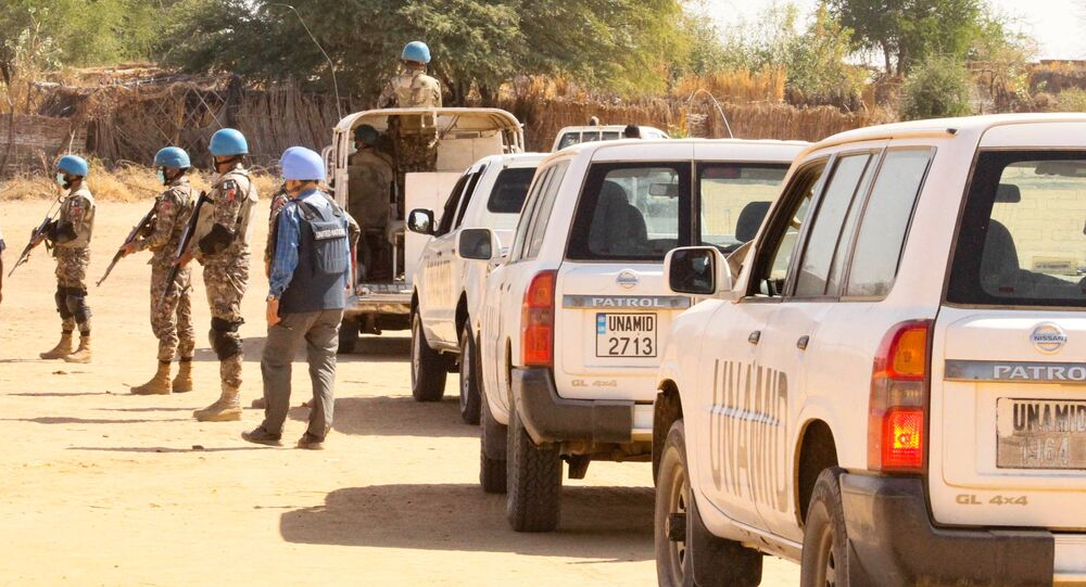 Members of the United Nations and African Union peacekeeping mission (UNAMID) gather with their vehicles in Kalma camp for internally displaced people in Nyala, the capital of South Darfur, on December 31, 2020.