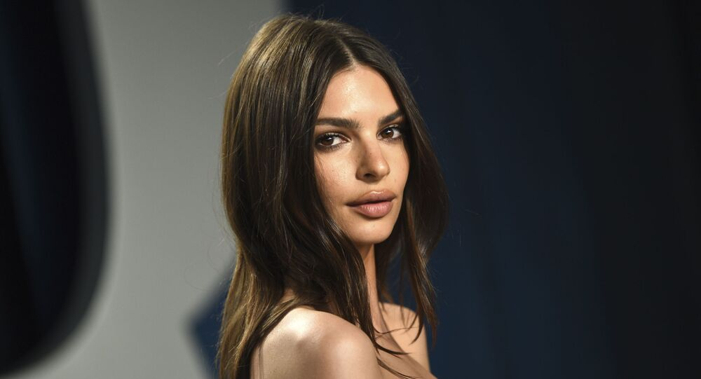 """Model Emily Ratajkowski arrives at the Vanity Fair Oscar Party in Beverly Hills, Calif., on Feb. 9, 2020. The British model and activist has a book deal. She is working on an essay collection called """"My Body."""" Metropolitan Books will publish it in 2022."""