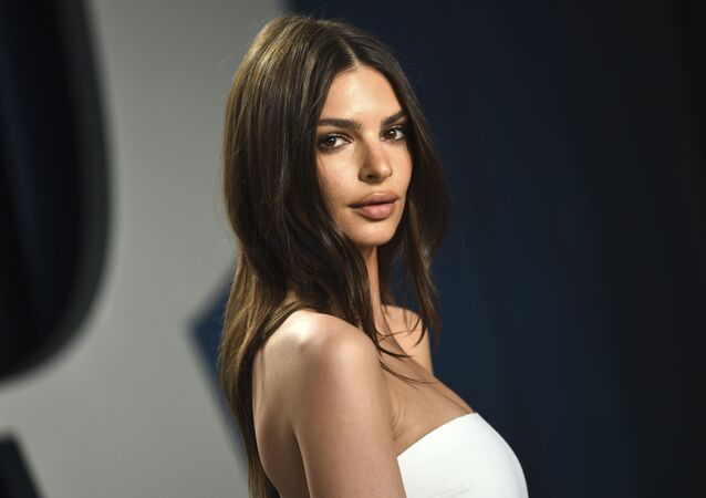 "Model Emily Ratajkowski arrives at the Vanity Fair Oscar Party in Beverly Hills, Calif., on Feb. 9, 2020. The British model and activist has a book deal. She is working on an essay collection called ""My Body."" Metropolitan Books will publish it in 2022."