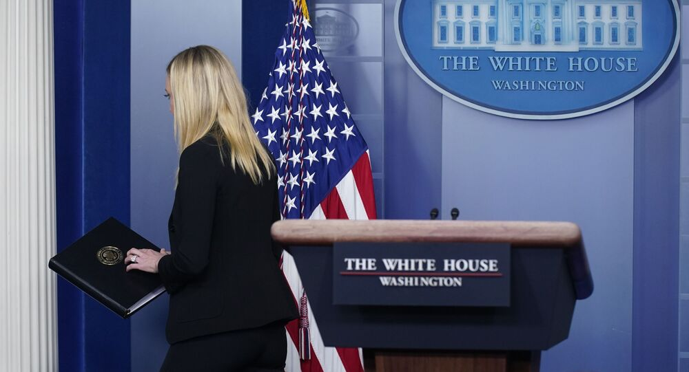 White House press secretary Kayleigh McEnany departs after delivering a statement at the White House, Thursday, Jan. 7, 2021, in Washington. (AP Photo/Patrick Semansky)