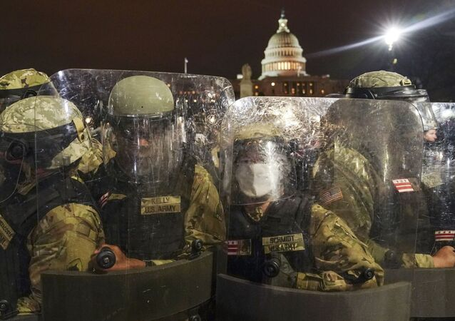 DC National Guard stand outside the Capitol, Wednesday night, Jan. 6, 2021, after a day of rioting protesters.