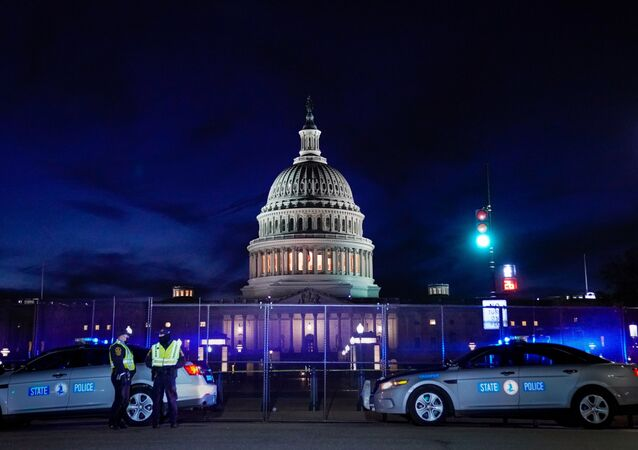 The U.S. Capitol is seen behind heavy-duty security fencing the day after supporters of U.S. President Donald Trump stormed the Capitol in Washington, U.S., January 7, 2021.