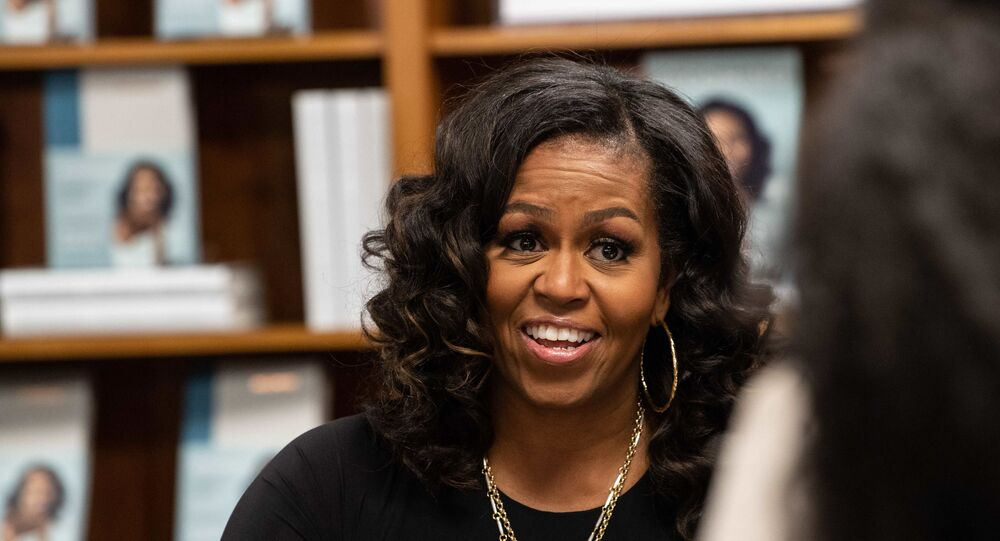 Former US first lady Michelle Obama meets with fans during a book signing on the first anniversary of the launch of her memoir Becoming at the Politics and Prose bookstore in Washington, DC, on November 18, 2019.