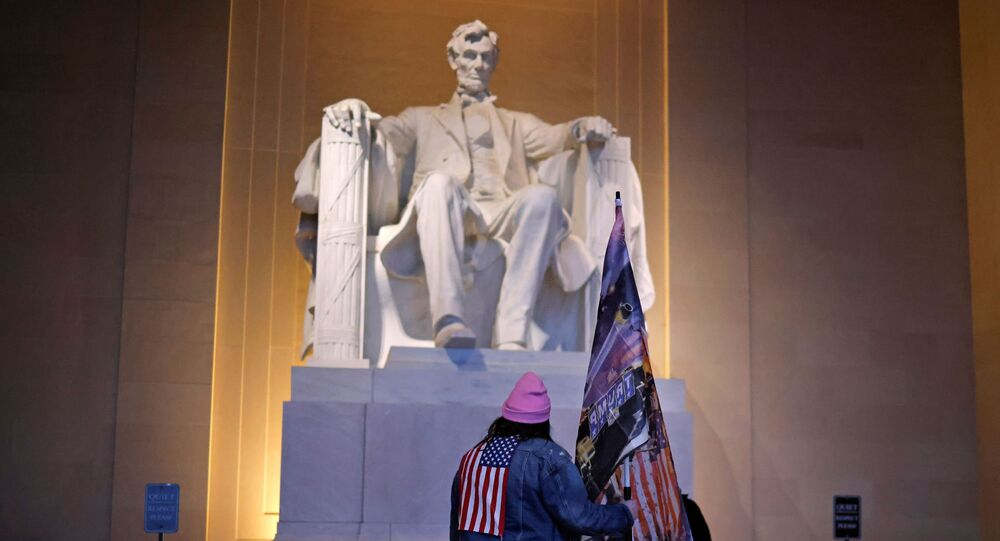 A supporter of U.S. President Donald Trump stands at the Lincoln Memorial, a day after Trump supporters stormed the U.S. Capitol, in Washington, U.S., January 7, 2021.