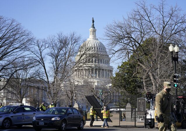 Workers install no-scale fencing around the U.S. Capitol in Washington, Thursday, Jan. 7, 2021.