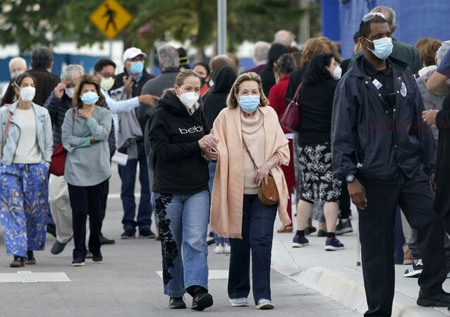 In this Jan. 6, 2021, file photo, people arrive at Jackson Memorial Hospital to receive the COVID-19 vaccine in Miami.