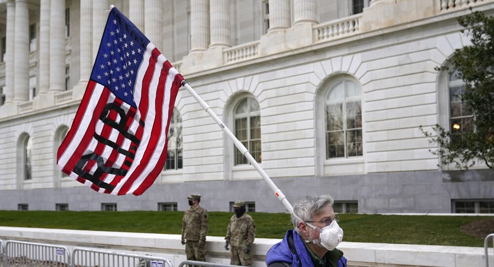 A protester walks past the Russell Senate Office Building on Capitol Hill in Washington, Friday, 8 January 2021.