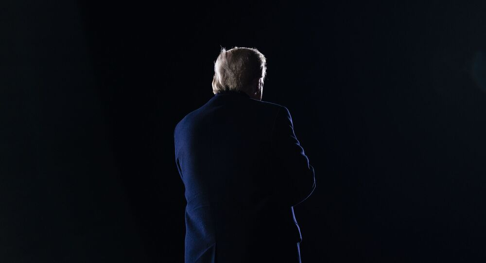 President Donald Trump walks off stage after speaking during a campaign rally for Sen. Kelly Loeffler, R-Ga., and Sen. David Perdue, R-Ga., at Dalton Regional Airport, Monday, Jan. 4, 2021, in Dalton, Ga.