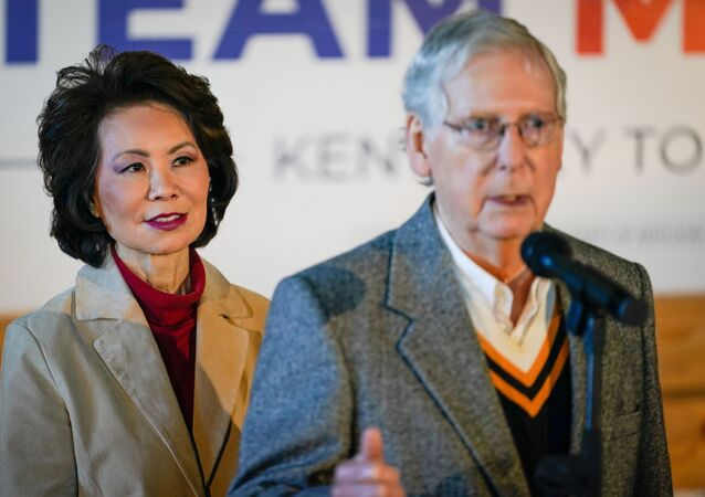 U.S. Secretary of Transportation Elaine Chao stands with her husband, Senate Majority Leader Mitch McConnell, at his final campaign event of the 2020 campaign for U.S. Senate, in Versailles, Kentucky, U.S., November 2, 2020.