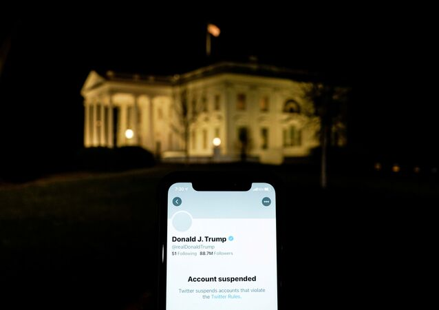 A photo illustration shows the suspended Twitter account of U.S. President Donald Trump on a smartphone and the White House in Washington, U.S., January 8, 2021.