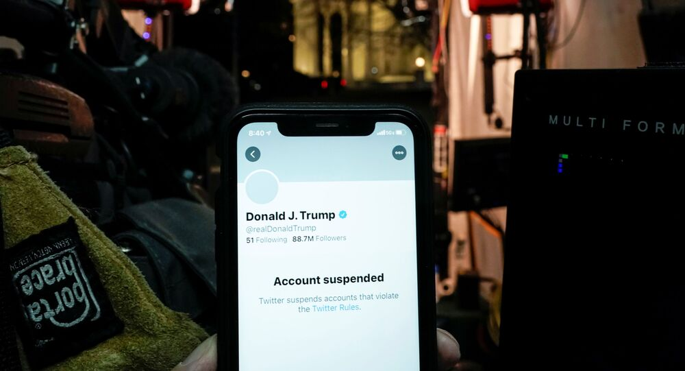 A photo illustration shows the suspended Twitter account of U.S. President Donald Trump on a smartphone in a media board cast tent at the White House in Washington, U.S., January 8, 2021.