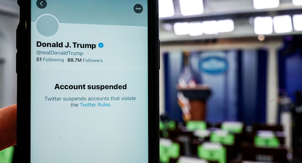 A photo illustration shows the suspended Twitter account of U.S. President Donald Trump on a smartphone at the White House briefing room in Washington, U.S., January 8, 2021.