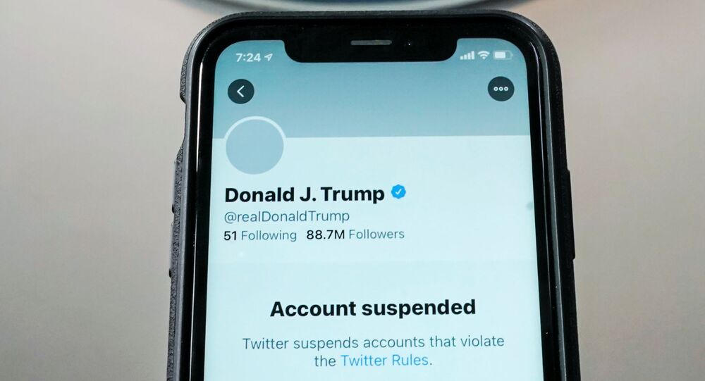A photo illustration shows the suspended Twitter account of U.S. President Donald Trump on a smartphone at the White House briefing room in Washington, DC, 8 January 2021.