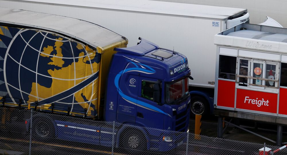 A lorry goes through the freight check in lane as it arrives at the port of Holyhead on the island of Anglesey, Britain, 14 December 2020