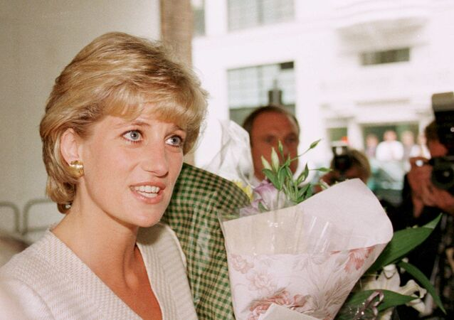 The Princess of Wales goes on a walkabout outside the Mortimer Market Centre in London, which she visited as patron of the National Aids Trust, Thursday, 27 June 1996