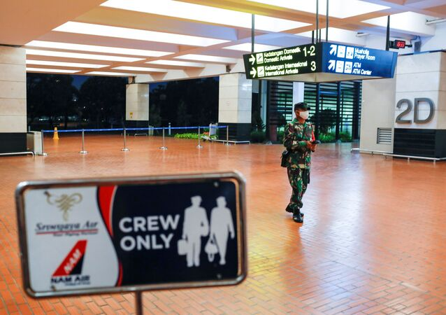 An Indonesian soldier walks at Soekarno-Hatta International Airport after Sriwijaya Air plane flight SJ182 with more than 50 people on board lost contact after taking off, according to local media, in Tangerang, near Jakarta, Indonesia, January 9, 2021.