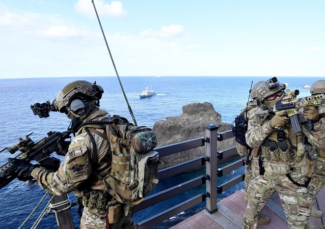 This handout photo taken on August 25, 2019 and provided by South Korean Navy shows South Korean Navy's special forces participating in a military drill re-named East Sea territory defence training at the easternmost islets of Dokdo.