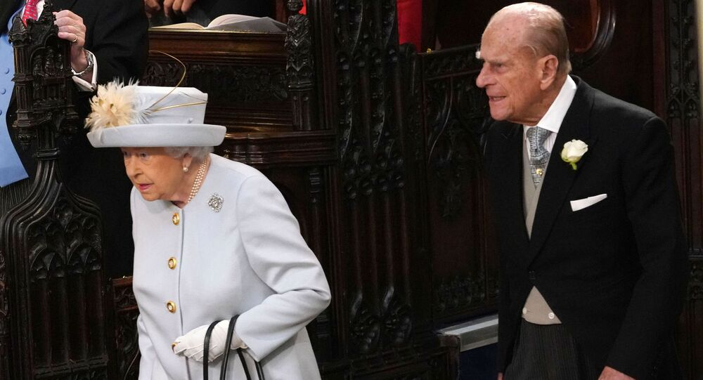 Britain's Queen Elizabeth II (L) and Britain's Prince Philip, Duke of Edinburgh (R) arrive to attend the wedding of Britain's Princess Eugenie of York to Jack Brooksbank at St George's Chapel, Windsor Castle, in Windsor, on October 12, 2018.