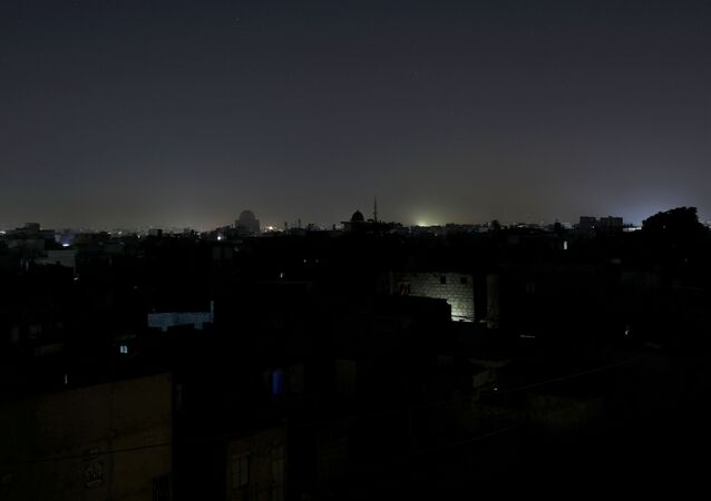 A general view of a residential area is seen during a power breakdown in Karachi, Pakistan, January 10, 2021.