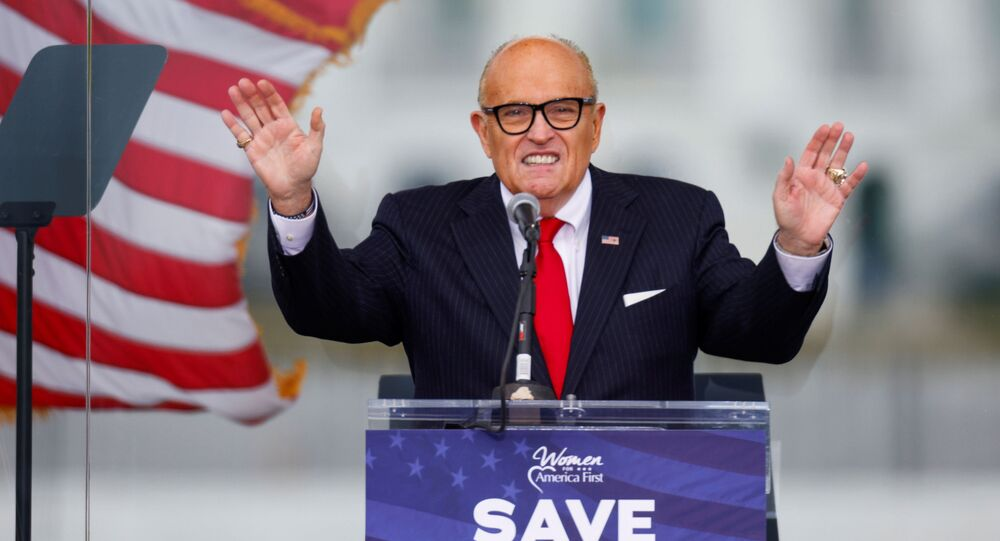 US President Donald Trump's personal lawyer Rudy Giuliani speaks as Trump supporters gather by the White House ahead of his speech to contest the certification by the US Congress of the results of the 2020 US presidential election in Washington, 6, January 2021.