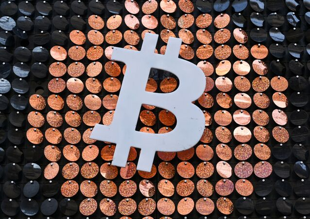 The logo of Bitcoin digital currency is pictured on the front door of an ATM in Marseille, southern France, on January 8, 2021.