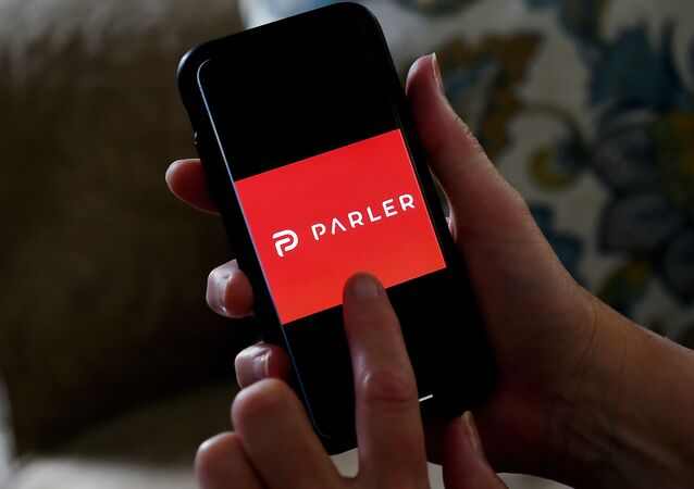This illustration file photo taken on July 2, 2020 shows social media application logo Parler displayed on a smartphone in Arlington, Virginia.