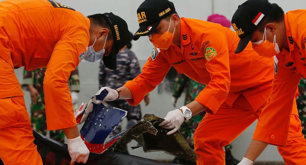 Indonesian rescue members inspect what is believed to be the remains of the Sriwijaya Air plane flight SJ182, which crashed into the sea, at Jakarta International Container Terminal port in Jakarta, Indonesia, January 10, 2021. REUTERS/Ajeng Dinar Ulfiana     TPX IMAGES OF THE DAY
