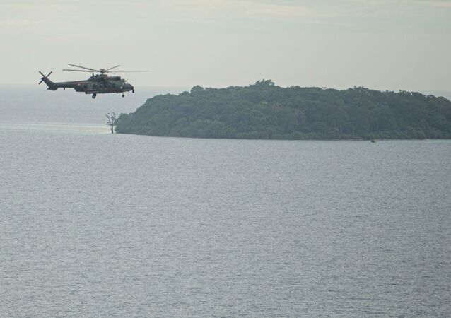 EC 725 Caracal helicopter TNI AU fly during an aerial search for the Sriwijaya Air SJ-182, which crashed to the sea in Jakarta, Indonesia, January 10, 2021, in this photo taken by Antara Foto/Aditya Pradana Putra/via Reuters.  ATTENTION EDITORS - THIS IMAGE WAS PROVIDED BY THIRD PARTY. MANDATORY CREDIT. INDONESIA OUT.