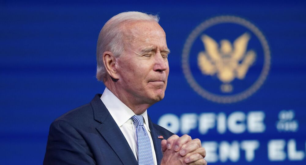 U.S. President-elect Joe Biden clasps his hands in prayer as he speaks about the violent protests in and around the U.S. Capitol in Washington, which forced members of Congress to suspend a joint session to certify the 2020 election results, during brief remarks at Biden's transition headquarters in Wilmington, Delaware, U.S., January 6, 2021. REUTERS/Kevin Lamarque