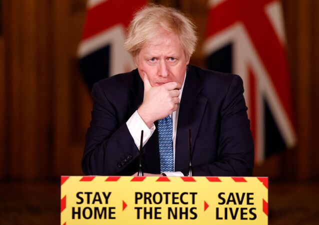 Britain's Prime Minister Boris Johnson reacts during a virtual news conference on the COVID-19 pandemic, at 10 Downing Street in London, Britain January 7, 2021
