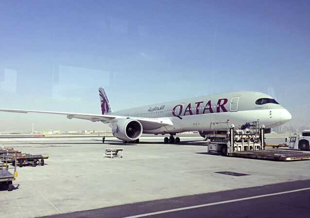 This June 6, 2017, file photo shows a parked Qatari plane in Hamad International Airport in Doha, Qatar.