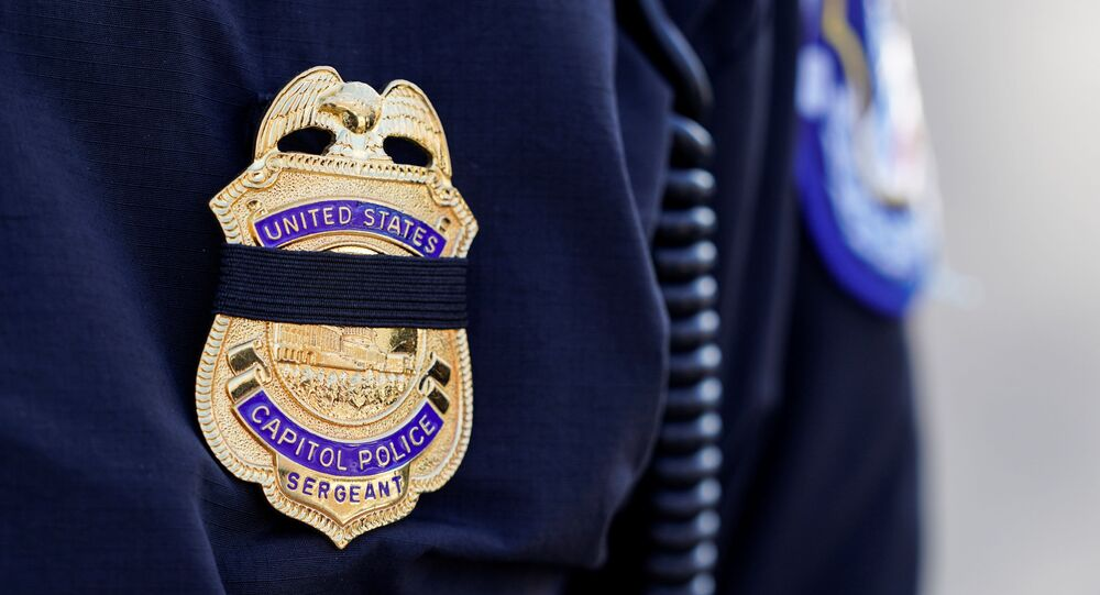 A Capitol Hill police officer wears a black band over his badge in honor of the police officer who died after supporters of U.S. President Donald Trump stormed the U.S. Capitol in Washington, U.S., January 10, 2021.