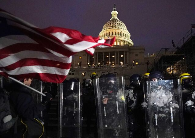 Police stand guard after a day of riots at the U.S. Capitol in Washington on Wednesday, Jan. 6, 2021