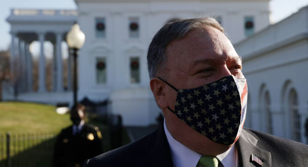 U.S. Secretary of State Mike Pompeo walks on the ground of the White House December 11, 2020 in Washington, DC