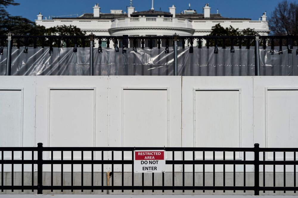 The White House is seen behind security fencing days after supporters of US President Donald Trump besieged the US Capitol in Washington, 10 January 2021.