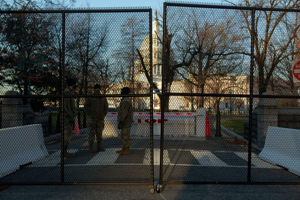 The US Capitol building is seen through newly erected fencing on Capitol Hill in Washington, 10 January 2021.