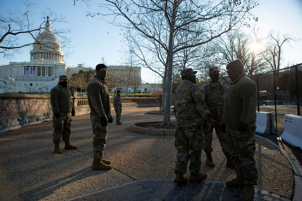 National Guard troops stand watch on the grounds of the US Capitol in Washington, 10 January 2021.