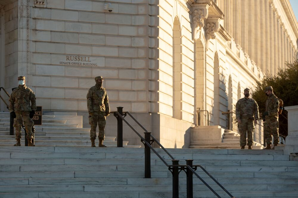 National Guard troops stand watch at the Russell Senate Office Building across from the US Capitol building on Capitol Hill in Washington, 10 January 2021.