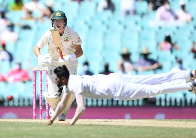 Marnus Labuschagne of Australia looks on as Mohammed Siraj of India dives for the ball during day four of the third test match between Australia and India at the SCG, Sydney, Australia, January 10, 2021