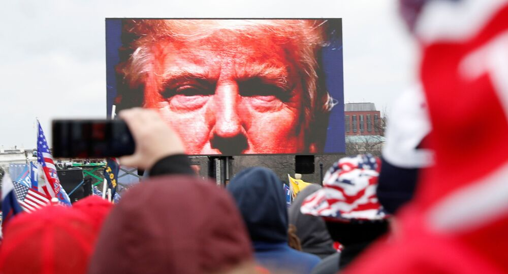 U.S. President Donald Trump is seen on a screen speaking to supporters during a rally to contest the certification of the 2020 U.S. presidential election results by the U.S. Congress, in Washington, U.S, January 6, 2021