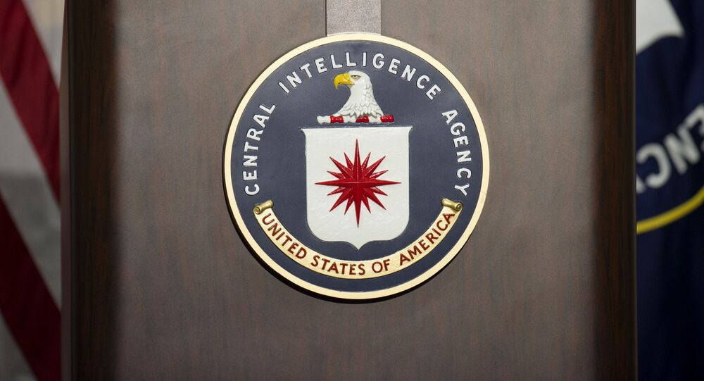 The lectern with CIA logo stands empty as reporters await the arrival of Director of Central Intelligence Agency John Brennan for a press conference at CIA headquarters in Langley, Virginia, December 11, 2014.
