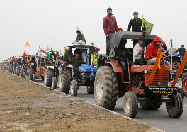Farmers participate in a tractor rally to protest against the newly passed farm bills at Singhu border near New Delhi, India, January 7, 2021