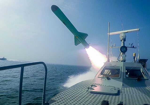 In this photo released Tuesday, July 28, 2020, by Sepahnews, a Revolutionary Guard's speed boat fires a missile during a military exercise