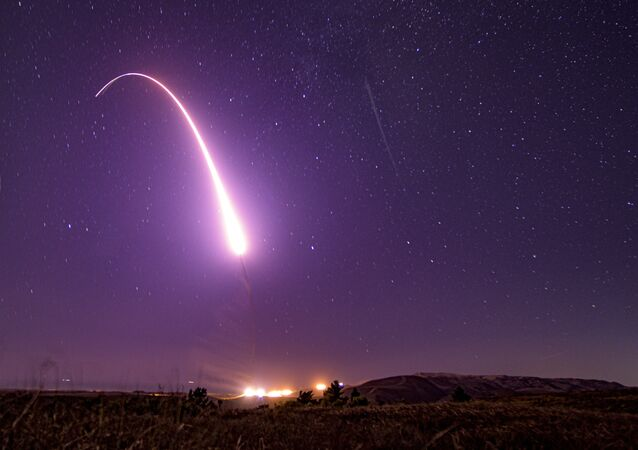 This image taken with a slow shutter speed on Oct. 2, 2019, and provided by the U.S. Air Force shows an unarmed Minuteman 3 intercontinental ballistic missile test launch at Vandenberg Air Force Base, Calif. The Pentagon has raised to $95.8 billion the estimated cost of fielding a new fleet of land-based nuclear missiles to replace the Minuteman 3