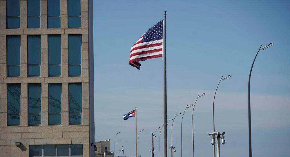 A view of Cuban and U.S. flags beside the U.S. Embassy in Havana, Cuba, December 15, 2020