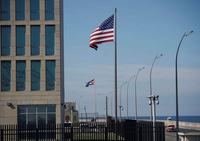 A view of Cuban and U.S. flags beside the U.S. Embassy in Havana, Cuba, December 15, 2020