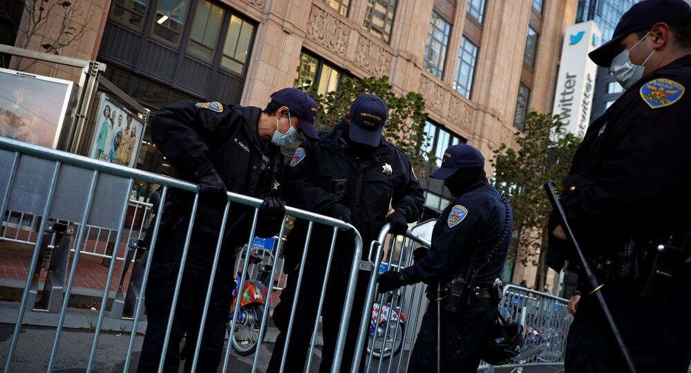Officers of the San Francisco Police Department barricade the sidewalk outside Twitter headquarters