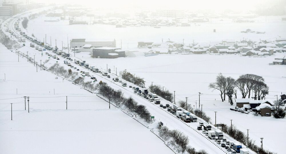 Vehicles are stranded in the snow on the Hokuriku Expressway in Fukui Prefecture, Japan