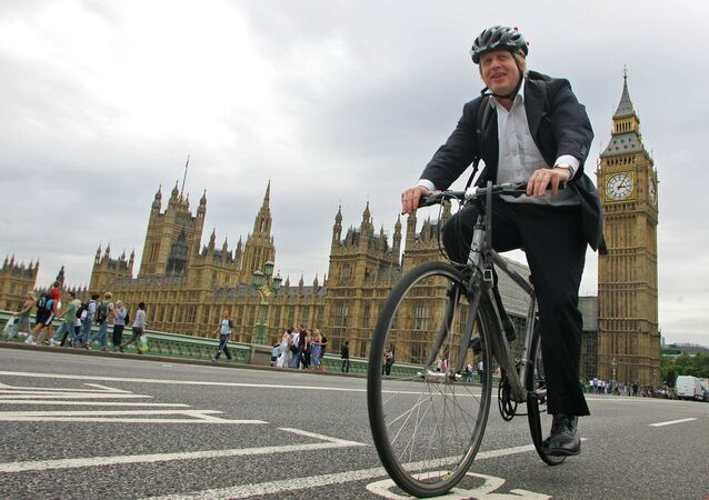 Boris Johnson cycles his bike over Westminster Bridge in central London on July 30, 2010.
