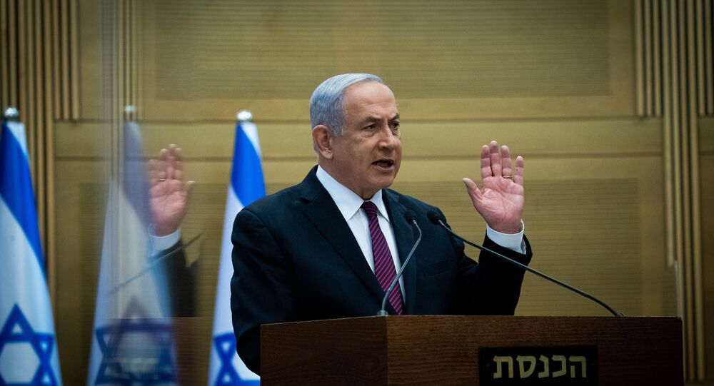 Israeli Prime Minister Benjamin Netanyahu delivers a statement to his Likud party MKs (members of Knesset), at the Likud centre in the Knesset in Jerusalem on December 2, 2020.